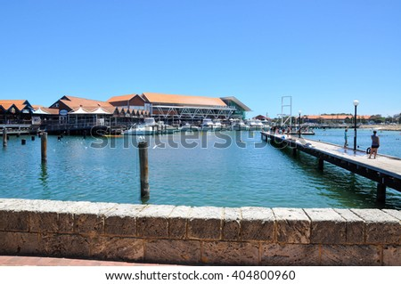 Hillarys Boat Harbour with marina and tourists in Hillarys,Western Australia/Harbour Scene/HILLARYS,WA,AUSTRALIA-JANUARY 22,2016: Tourists at Hillarys Boat Harbour in Hillarys,Western Australia. - stock photo
