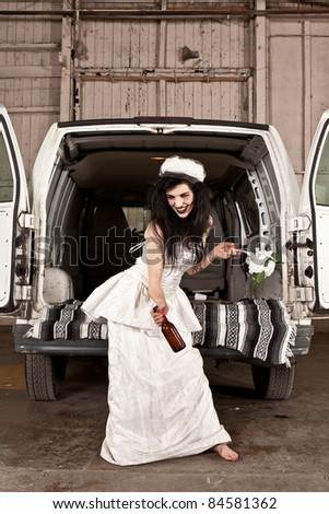 Hillbilly bride with a beer - stock photo