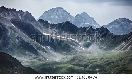 Hills and mountaintops at the Swiss side of the Stelvio pass in the Alps. - stock photo