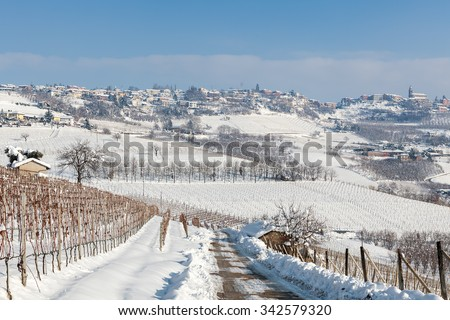Hills and vineyards of Langhe covered with snow in Piedmont, Northern Italy. - stock photo