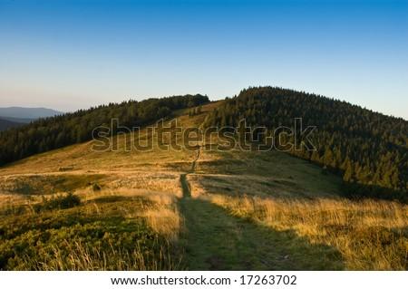 Hills at sunrise - stock photo