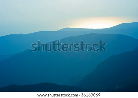Hills in sunset haze - stock photo