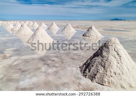 Hills of salt - salt extraction area at the world's biggest salt plain Salar de Uyuni, Bolivia - stock photo