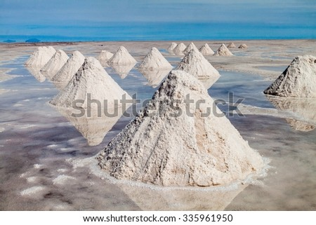 Hills of salt - salt extraction area at the world's biggest salt plain Salar de Uyuni, Bolivia - stock photo