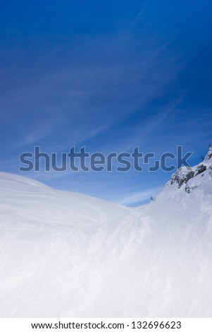 hills of snow on a intense blue sky background