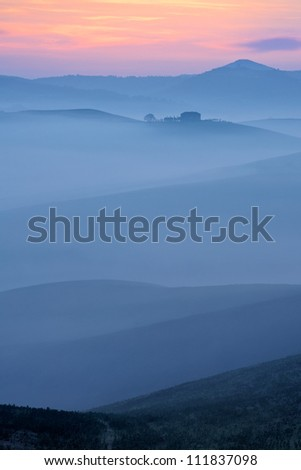 Hills of Tuscany in blue morning atmosphere, Italy - stock photo