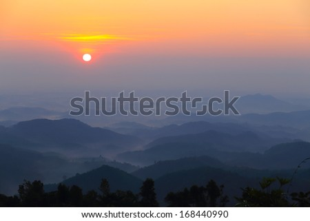 Hills on a colorful misty morning in Chiang Rai,Thailand - stock photo