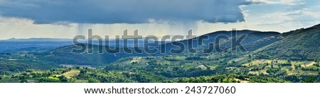 Hills with olive groves, panoramic view over the countryside of Tuscany, Italy  - stock photo