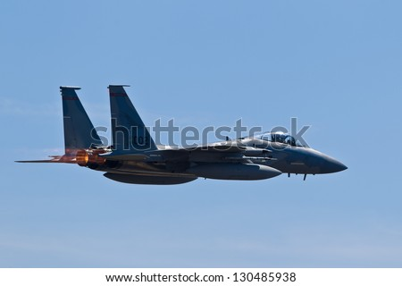 HILLSBORO, OR - AUG 5: Oregon Air National Guard F-15 Eagle aircraft fly by during Oregon Air Show at Hillsboro Airport on August 5, 2012 in Hillsboro, OR. - stock photo