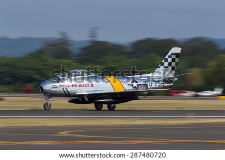 HILLSBORO, OR - SEPT 21: P-51 North American F-86F Sabre demonstration during Oregon International Air Show at Hillsboro Airport on September 21, 2014 in Hillsboro, OR.