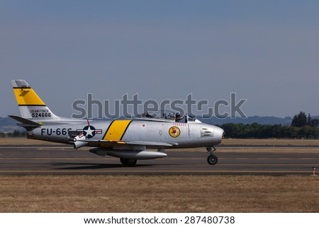 HILLSBORO, OR - SEPT 21: P-51 North American F-86F Sabre demonstration during Oregon International Air Show at Hillsboro Airport on September 21, 2014 in Hillsboro, OR.  - stock photo