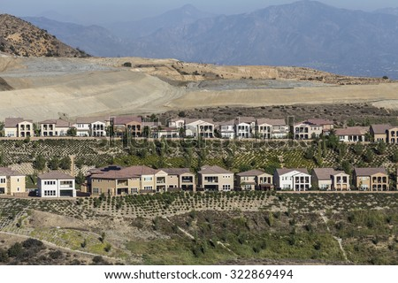 Hillside home construction in the Porter Ranch neighborhood of Los Angeles, California. - stock photo