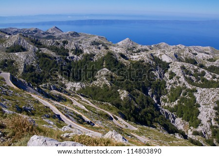 Hilltop panorama of picturesque nature park Biokovo on Dalmatian coast near Makarska Riviera in Croatia - stock photo