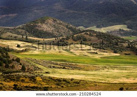 Hilly mountains farming scenery  - stock photo