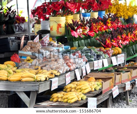 Hilo's Farmer's Market is filled with fruits and vegetables and buckets and bouquets of fresh cut tropical flowers. - stock photo