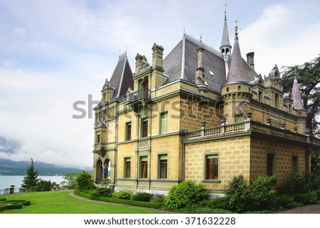 HILTERFINGEN, SWITZERLAND- JUNE 15, 2015: Castle Hunegg. Castle was built in 1861-63 for the Prussian Baron Albert Emil Otto von Parpart. Today it houses the Renaissance Revival and Art Nouveau Museum - stock photo
