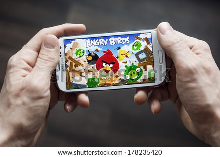 HILVERSUM, NETHERLANDS - FEBRUARY 23, 2014: Angry Birds is a video game by Finnish game developer Rovio Entertainment first released for iOS in 2009. It sold over 2 billion copies across all platforms - stock photo