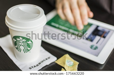 HILVERSUM, NETHERLANDS - FEBRUARY 06, 2014: Starbucks Corporation is an American global coffee company and coffeehouse chain based in Seattle, Washington founded in 1971 with stores in 62 countries. - stock photo