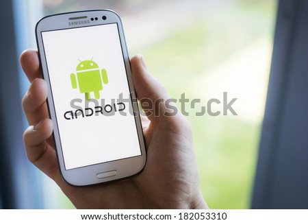 HILVERSUM, NETHERLANDS - MARCH 17, 2014: Android is an operating system based on the Linux kernel and designed for touchscreen mobile devices. The mobile HTC Dream, was successfully released in 2008. - stock photo