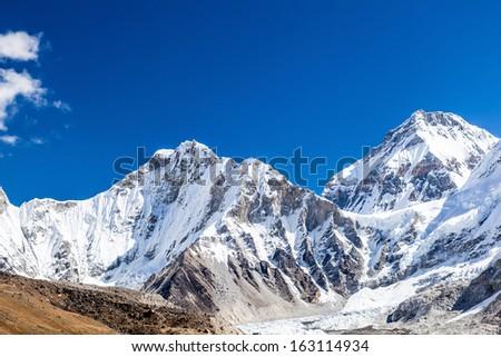 Himalaya beautiful mountain peaks autumn landscape and Khumbu glacier with Everest Base Camp. Khumbutse 6640m and Changtse 7543m in Everest National Park. - stock photo