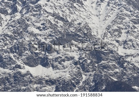 Himalaya mountain fragment covered with snow at daybreak - stock photo