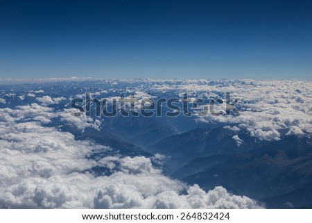 Himalaya mountains under clouds. View from the airplane. India, Ladakh - stock photo