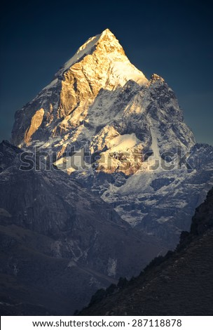 Himalayan Gold. Nepal, Everest region, view from the Tengboche (3,860 m) to Pharilapche Peak (6,073 m) - stock photo