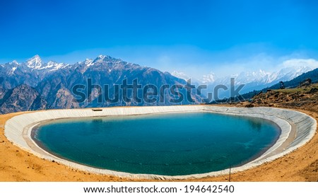 Himalayan landscape with an artificial lake in the early morning, India. - stock photo