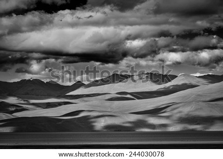 Himalayan mountain lake in Himalayas Tso Moriri (official name: Tsomoriri Wetland Conservation Reserve), Korzok,  Changthang area, Ladakh, Jammu and Kashmir, India. Black and white version - stock photo
