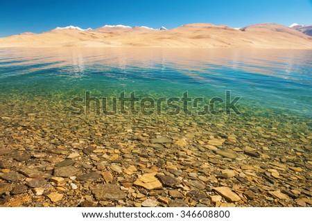 Himalayan mountain lake in Himalayas Tso Moriri, Tsomoriri Wetland Conservation Reserve, Korzok  Changthang area, Ladakh, Jammu and Kashmir, India. - stock photo