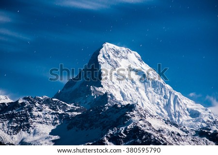 Himalayan mountain peak during night (Annapurna peak in Nepal ) - stock photo