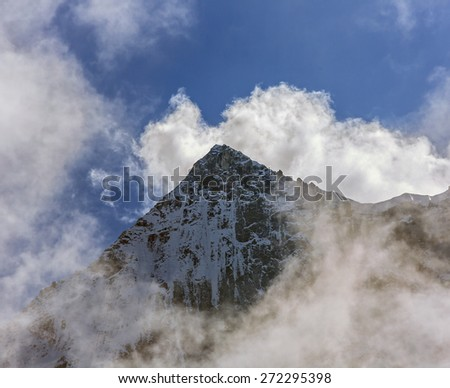 Himalayan peak near Thame village in the clouds - Everest region, Nepal - stock photo