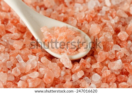 Himalayan pink salt background - stock photo