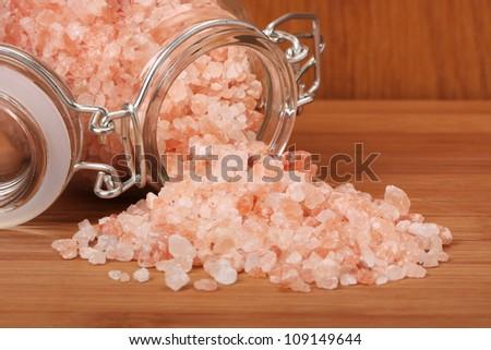 Himalayan pink salt in small jar of glass. - stock photo