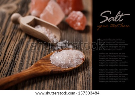 Himalayan pink salt in wooden spoon - stock photo