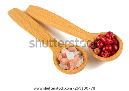 himalayan salt and red peppercorns in a spoon over white - stock photo