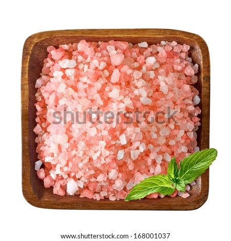 Himalayan salt in bowl with mint leaves from top including clipping path