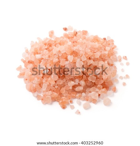 Himalayan salt pile on white background - stock photo