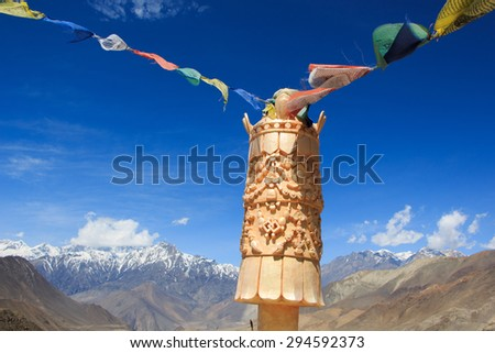 Himalayan view with colorful prayer flags and clear blue sky in Muktinath, Upper Mustang, Nepal