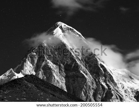 Himalayas at night. Mt. Pumori (Pumo Ri). Everest region, Nepal. Black and White - stock photo