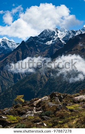 Himalayas in autumn: peaks and clouds. Hiking in Nepal - stock photo