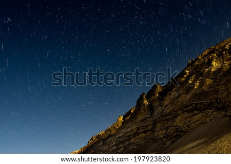 himalayas mountain in night with startrails - stock photo