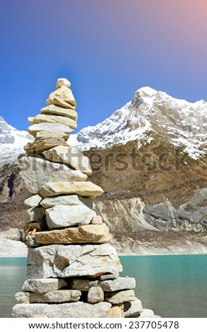 Himalayas mountain landscape with stone tower - stock photo