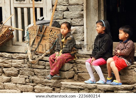 HIMALAYAS, NEPAL, MARCH 20: Nepalese children near the house. Everest region, Himalayas, in Nepal on March 20, 2014  - stock photo