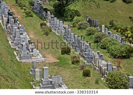 HIMEJI, JAPAN - APRIL 23, 2012: Nagoyama Cemetery in Himeji, Japan. Nagoyama is the largest cemetery in the city of Himeji. More than 110,000 soldiers are buried here.