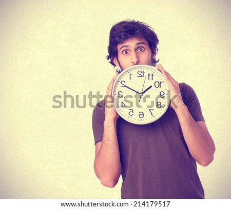 Hindu cool young man with a clock