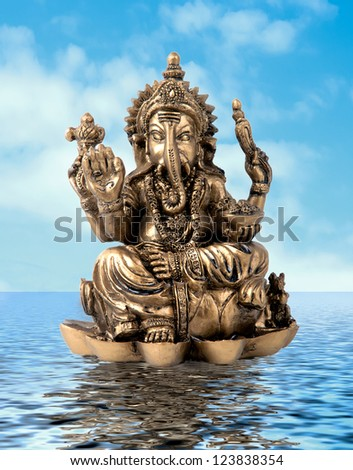 Hindu God Ganesh over de water whith a blue sky - stock photo