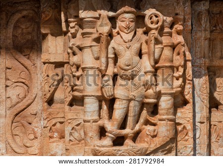 Hindu god in carved patterned temple wall in India - stock photo