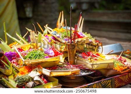 Hindu offerings and gifts to god in the temple in Bali, Indonesia - stock photo