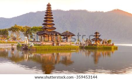 Hindu procession in Ulun Danu temple Beratan Lake in Bali Indonesia, - stock photo